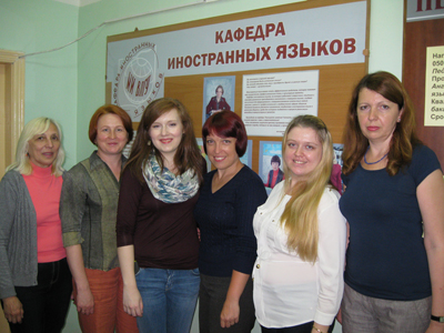 Russian collegues are glad to talk to the young American teacher